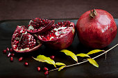 Winter pomegranate still life with low key lighting