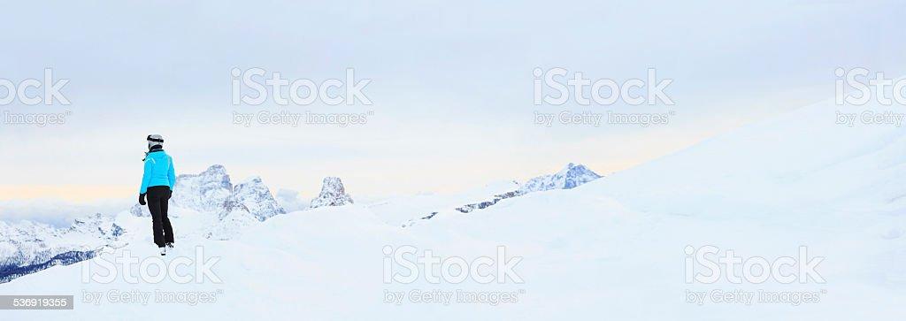 Winter portrait of a teenage girl snow skier stock photo
