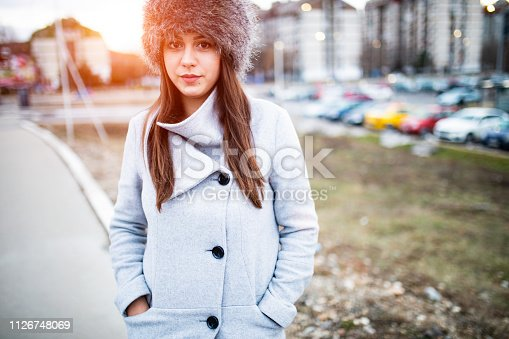 Winter fashion portrait of a young woman in the city ,