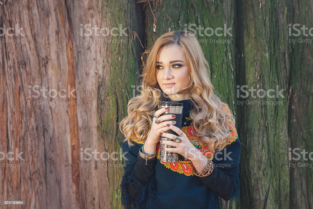 Winter portrait of a young woman, drinking tea stock photo