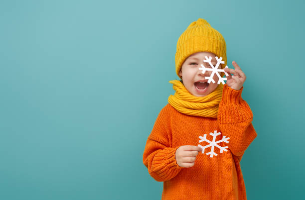 Winter portrait of happy child stock photo