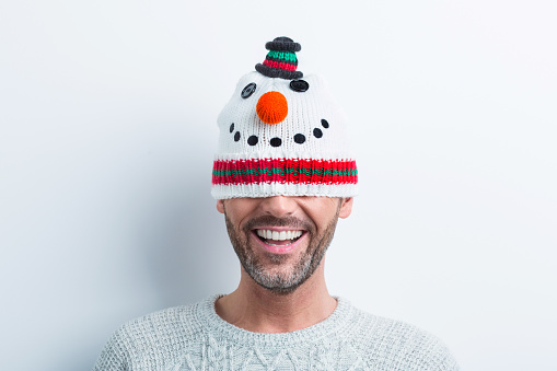Winter Portrait Of Happy Man Wearing Snowman Kit Hat Stock Photo - Download Image Now