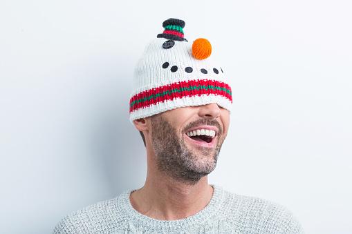 Winter Portrait Of Happy Man Wearing Snowman Kit Hat Stock Photo - Download Image Now