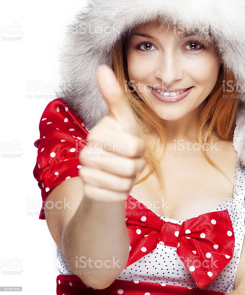 Winter portrait of joyful woman showing ok sign royalty-free stock photo