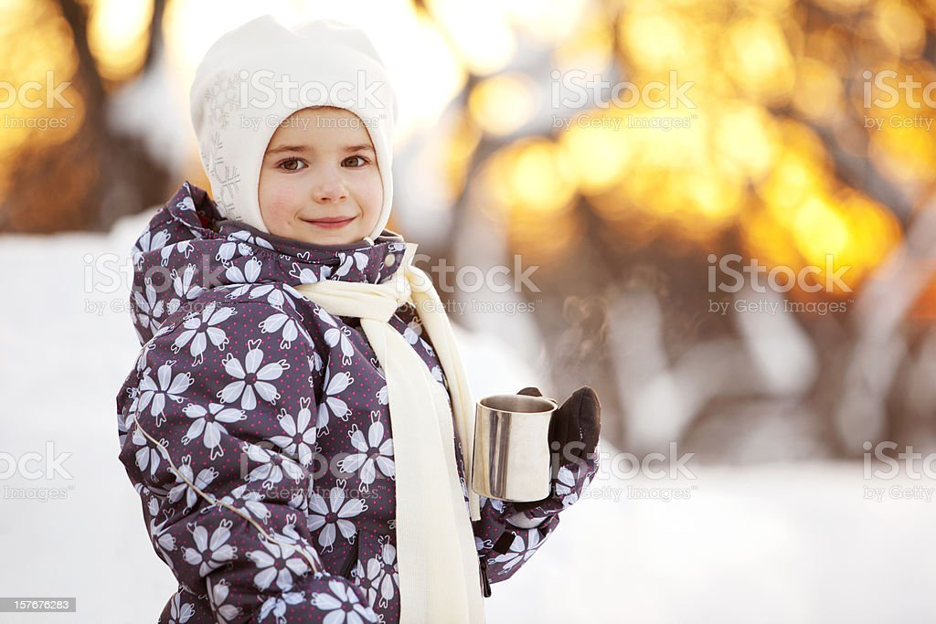 Winter Portrait of Little Girl Drinking Tea Outdoors royalty-free stock photo