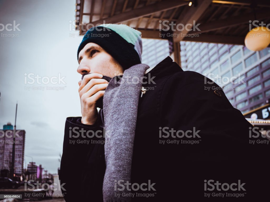 winter portrait of man in jacket with scarf outside in the city - Royalty-free Adult Stock Photo