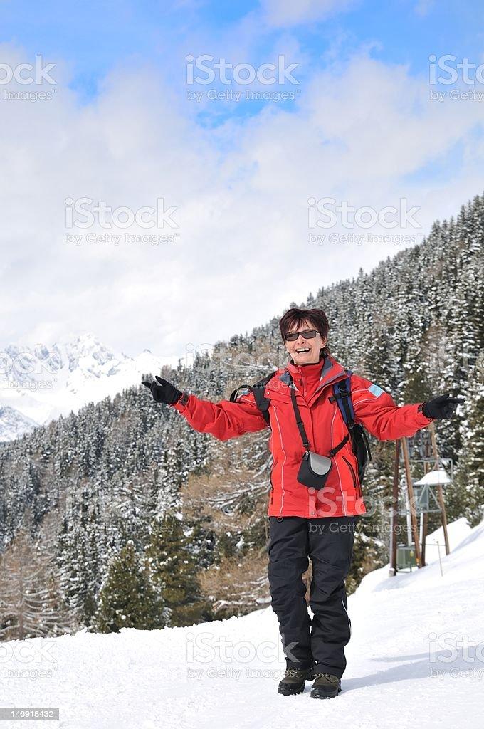 Winter portrait of senior woman in mountain snowy land royalty-free stock photo