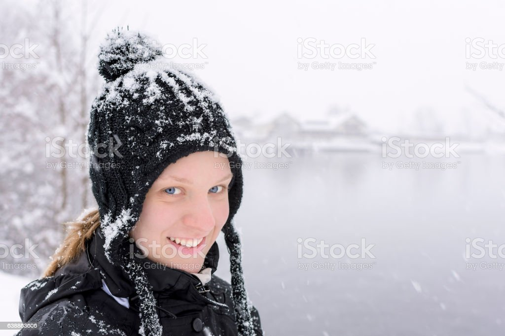 Winter Portrait of Young Woman with Blue Eyes stock photo