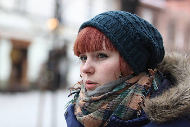 winter portrait - woman green eyes red hair stock photos and pictures