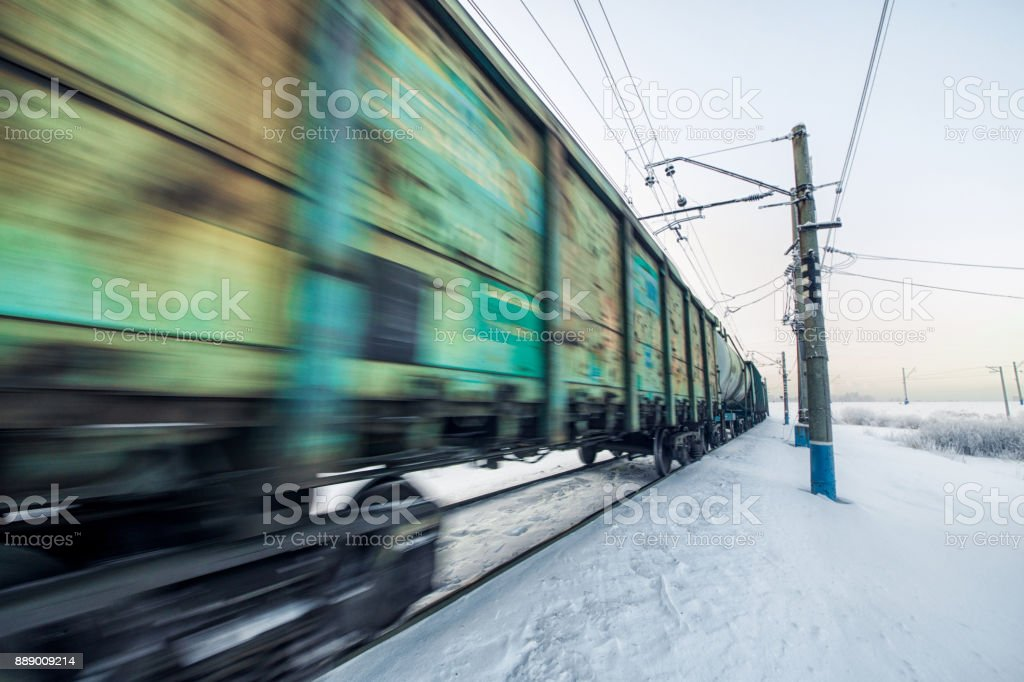 Winter railway and train with cargo. stock photo
