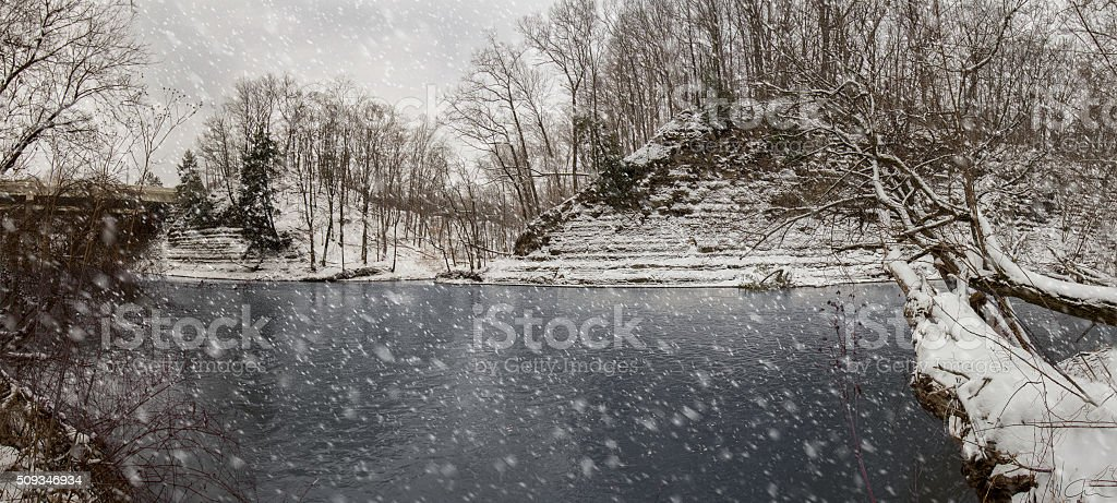 Winter River and Snow Falling stock photo