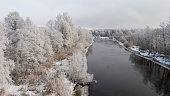 winter river, Colorful landscape with snowy trees, beautiful frozen river, frost covered trees and forest, beautiful winter scenery, christmas card, drone photography, Drone point view, aerial view over the landscape,