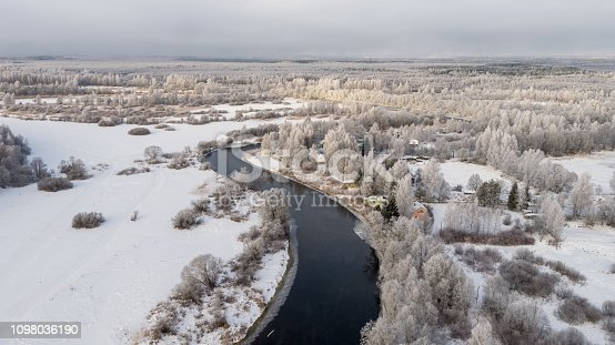 Drone point view, aerial view over the landscape, frost covered landscape, very cold morning. frost covered forest, airy view of the landscape - forest, river. drone photography