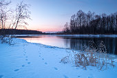 Colorful winter sunset in forest and river, winter river at sunset, an icy river, full frame photo, high resolution landscape photo, winter nature image