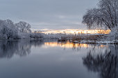 landscape with snowy trees, beautiful river, snowcovered