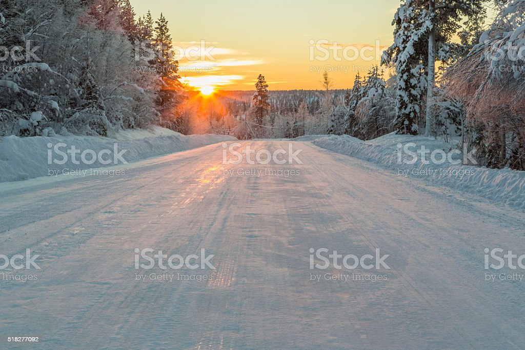 Winter road in direct light stock photo