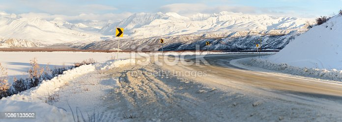 Winter Road Panorama With Snow Capped Mountain Background