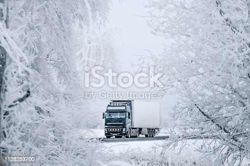 1127834626 istock photo winter road transportation truck. 1128253700
