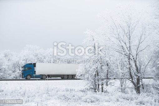 1127834626 istock photo winter road transportation truck. 1128253702