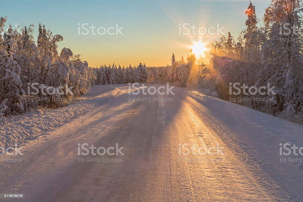 Winter road with direct light stock photo