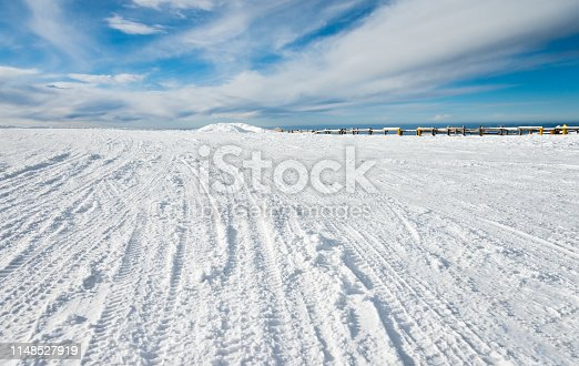Winter road with tracks in snow.