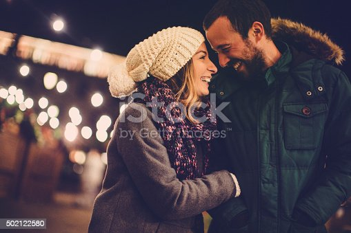 Romantic couple sharing their affection on Valentine's day, while walking outdoors