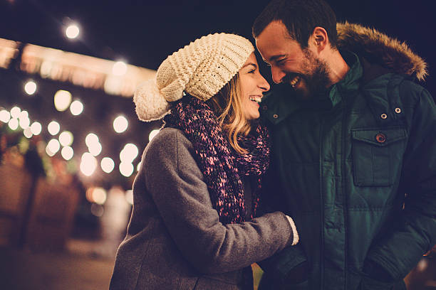 Winter romance Romantic couple sharing their affection on Valentine's day, while walking outdoors  calendar date stock pictures, royalty-free photos & images