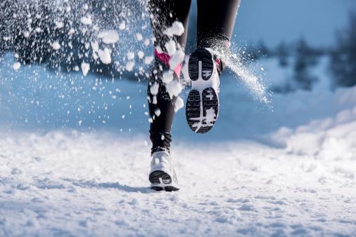 Winter running woman