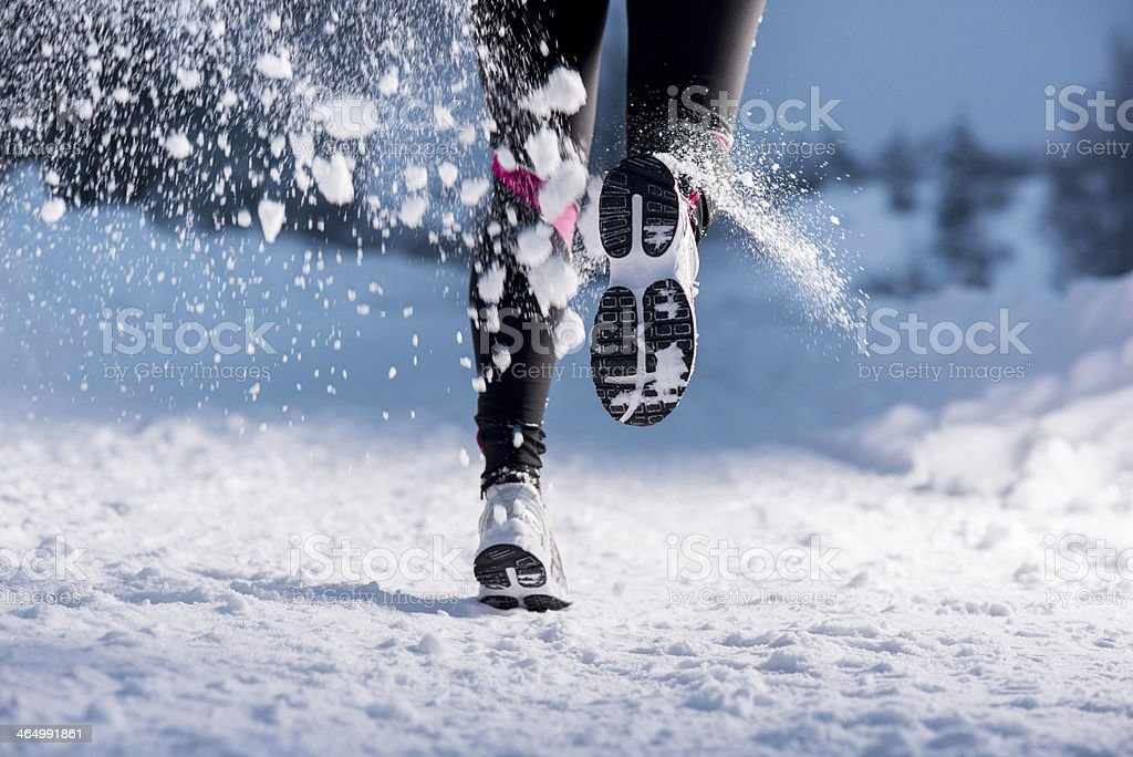 Winter running woman stock photo