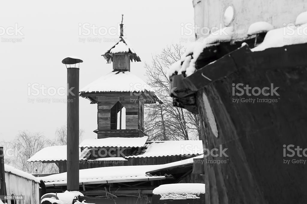 Winter rural landscape with a view of the Russian village. stock photo