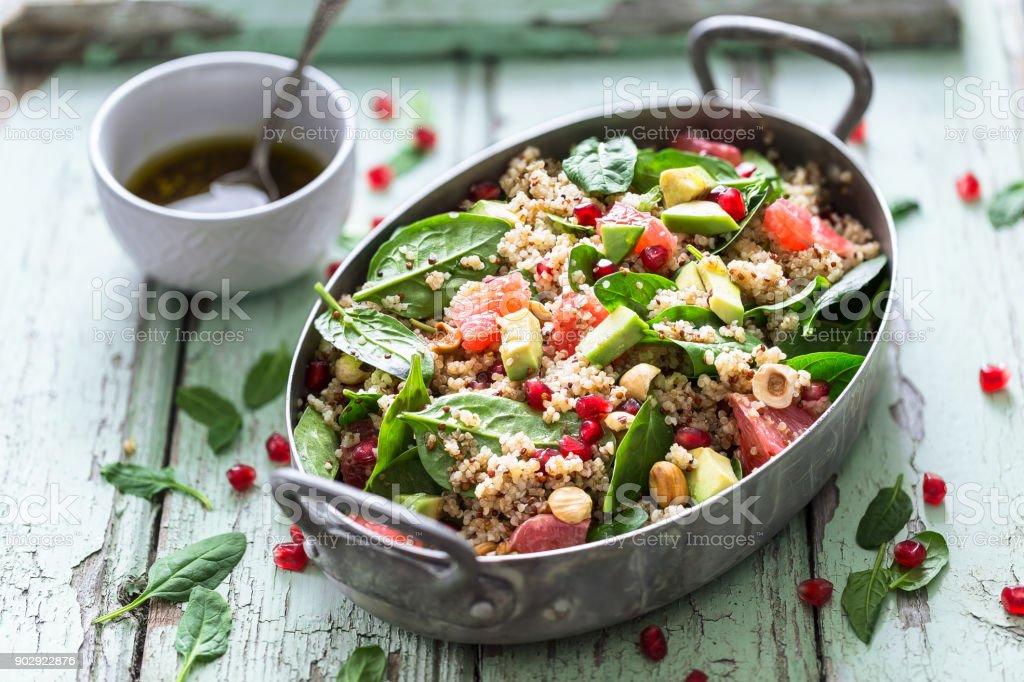 Winter Salad with Quinoa, Avocado, Blood Orange, Pomegranate, Bulgur, Hazelnuts stock photo