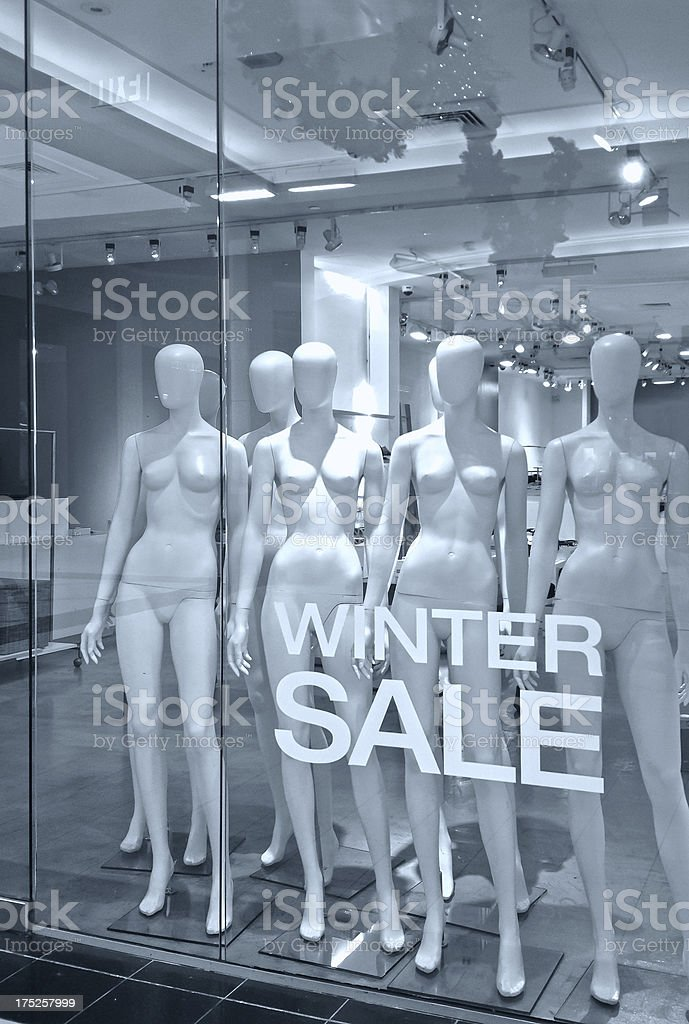 Winter sale sign in front of naked female mannequins royalty-free stock photo