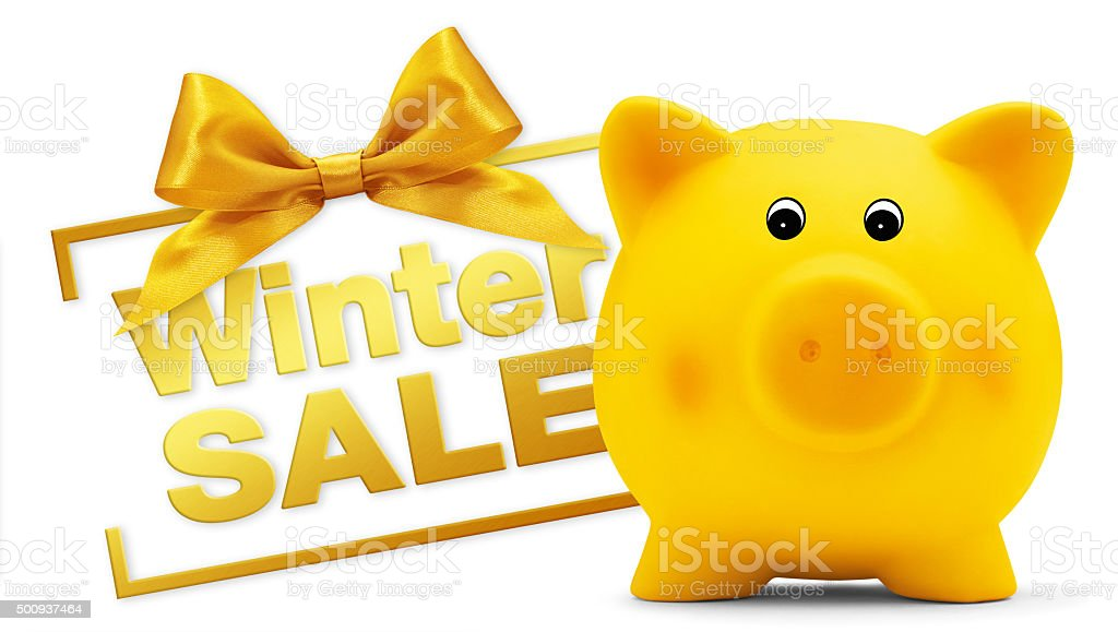 winter sale text with piggy bank, golden ribbon bow, Isolated stock photo