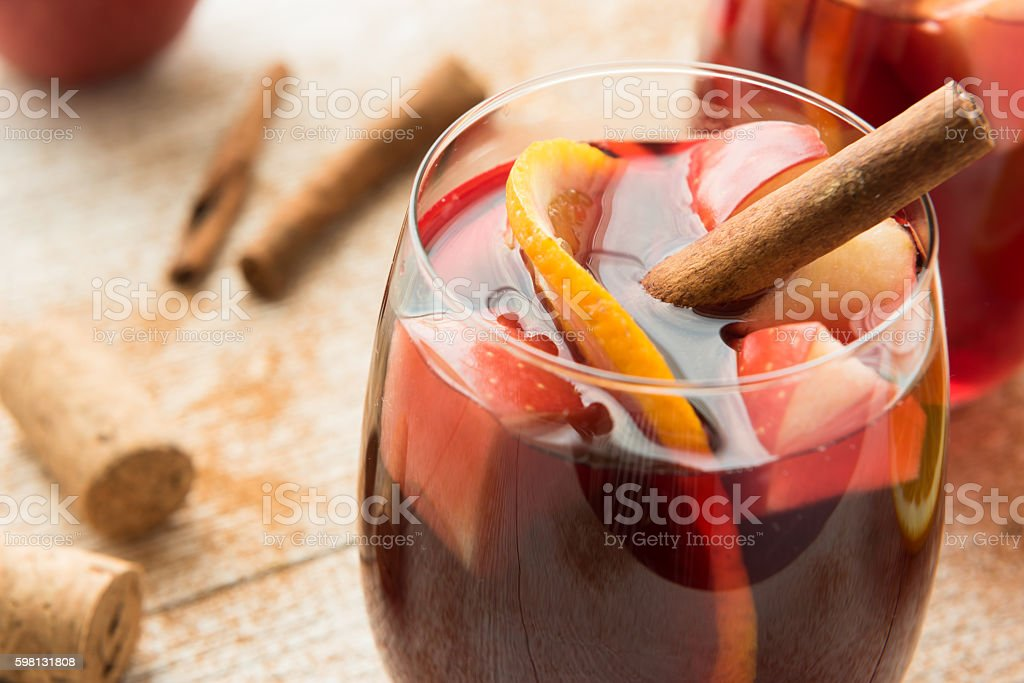 Winter sangria with citrus, apples and cinnamon stock photo