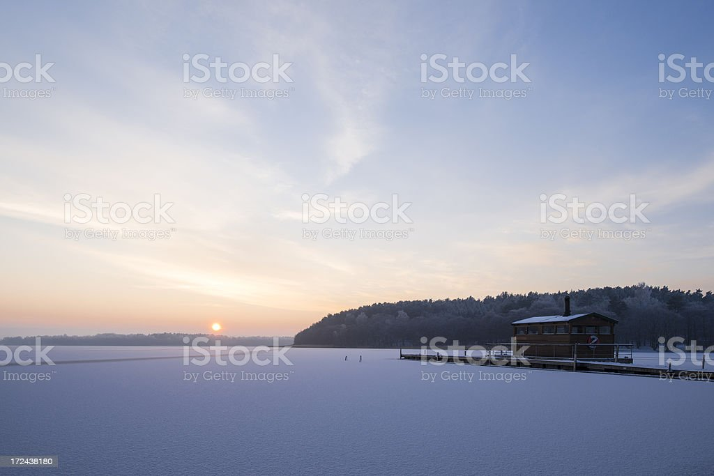 Winter sauna by the lake with ice and snow (XXXLarge) royalty-free stock photo