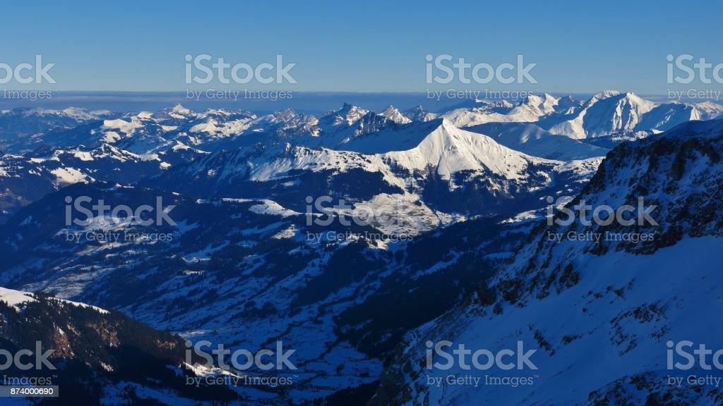 Winter scene in Switzerland. View from the Diablerets glacier. Sunlit mount Lauenenhorn. stock photo