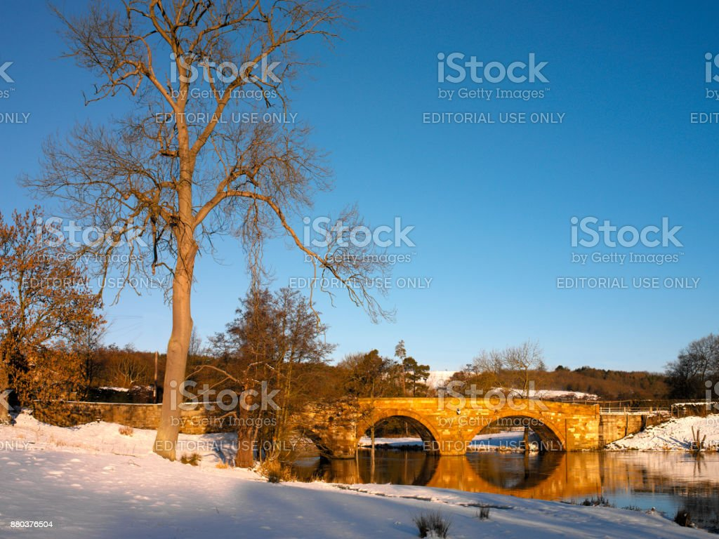Winter scene of a bridge over the River Derwent - Yorkshire - England stock photo