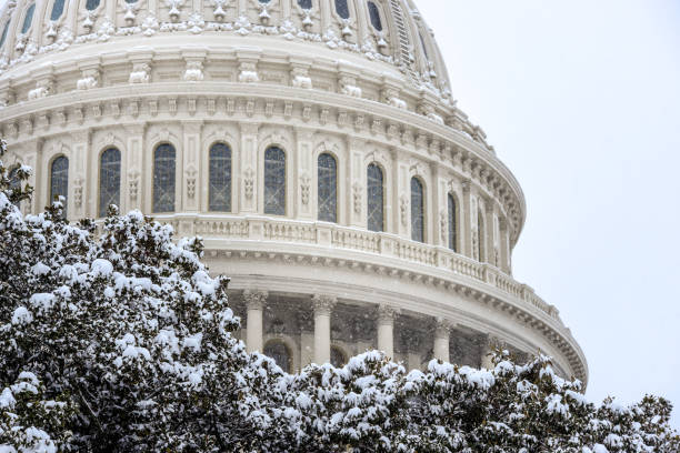 Winter scene of The United States Congress - Capitol Building covered with snow Capitol building, The United States Congress covered with snow in winter time and Capitol hill area covered with snow foreign affairs stock pictures, royalty-free photos & images