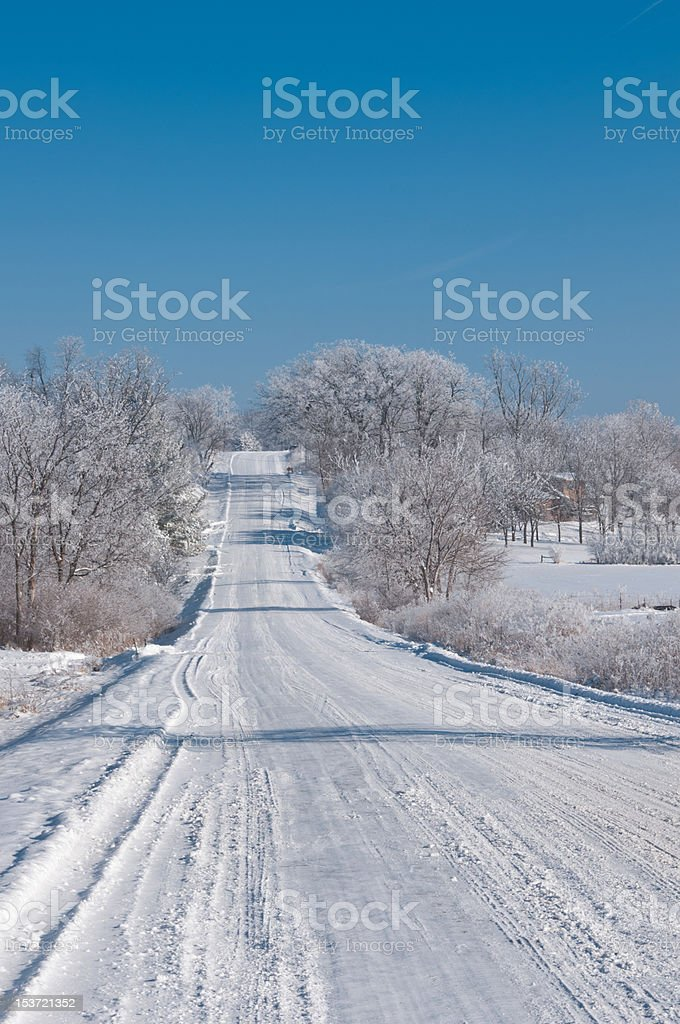 Winter scene on a country road in rural Iowa stock photo