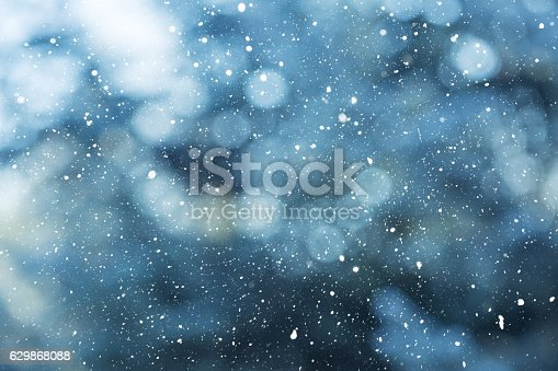 Winter scene background - snowfall on the blurred background