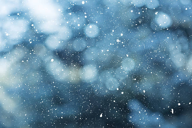 winter scene - snowfall on the blurred background - weather stock photos and pictures