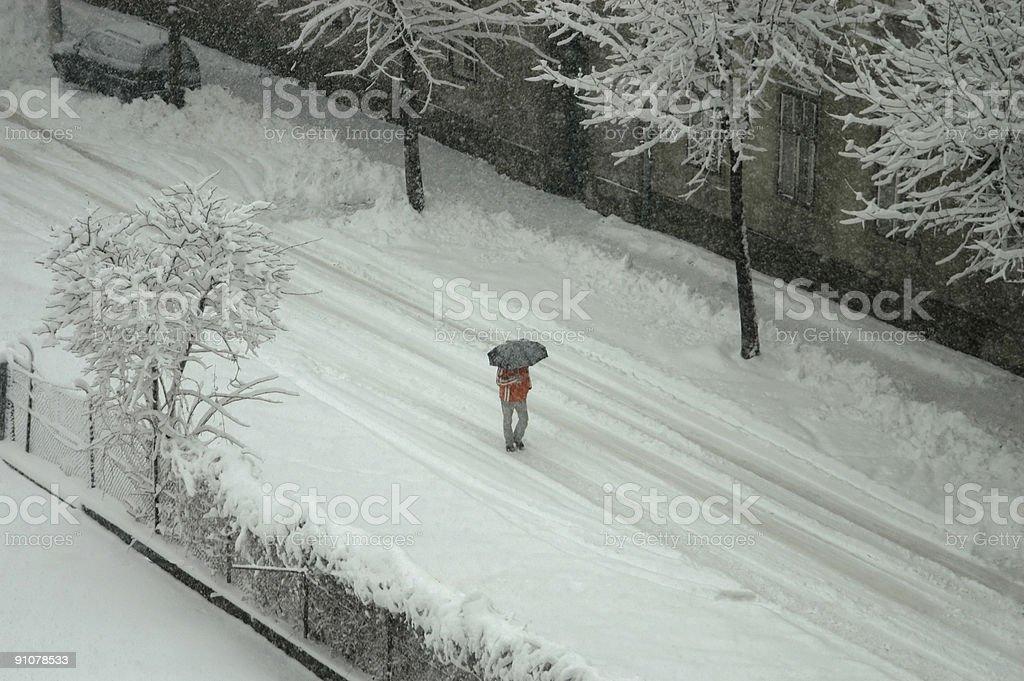 Winter scene -  walking on snowy road stock photo
