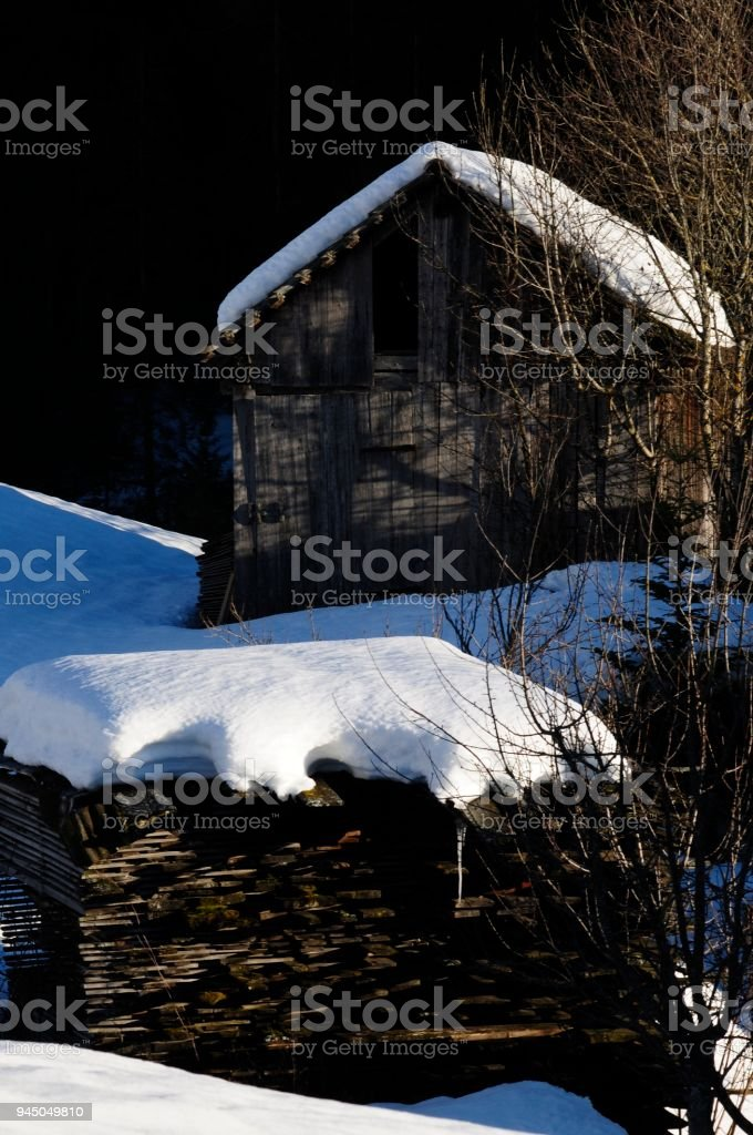 Winter scene with an old wooden hut stock photo