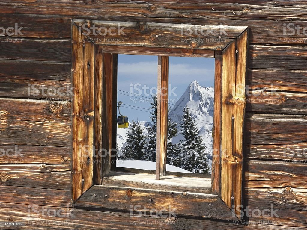 Winter scenery and a cable car in the window royalty-free stock photo