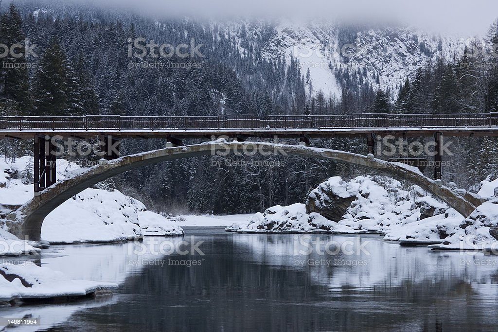 Winter Scenic With Bridge, Water, and Mountain royalty-free stock photo