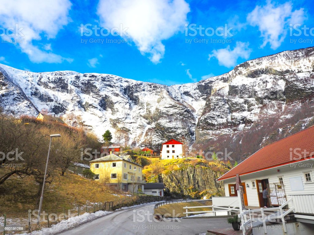 Winter season view of snow mountain behind the village with bright blue sky, Flam Norway stock photo