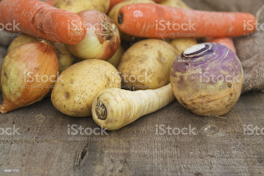 Winter seasonal vegetables including potatoes parsnips swede and carrots stock photo