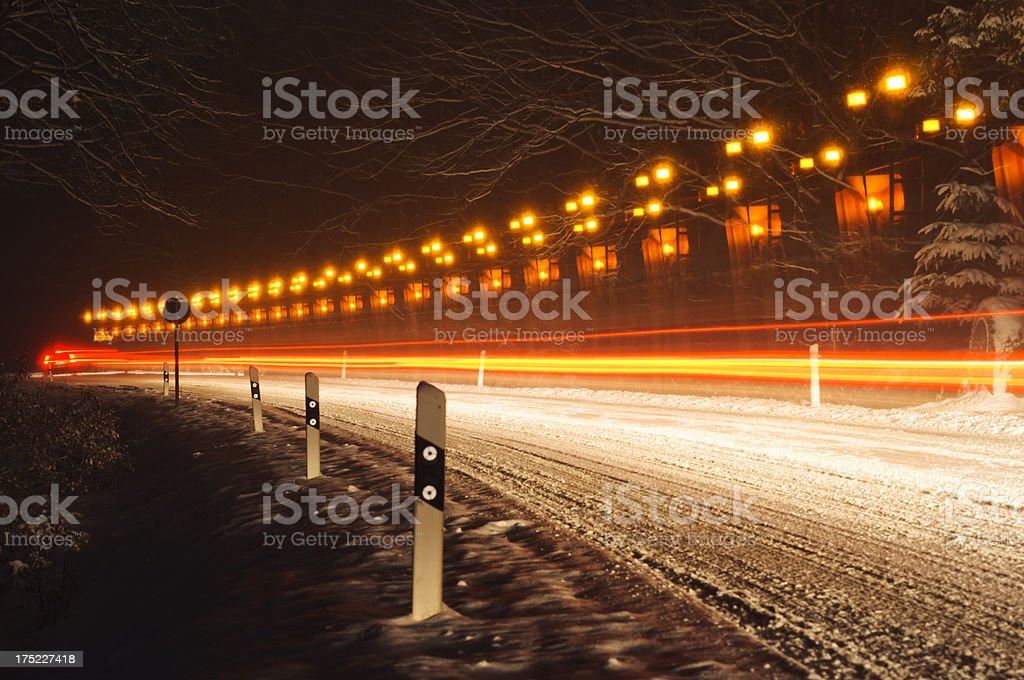 Winter service vehicle on a wintry road royalty-free stock photo