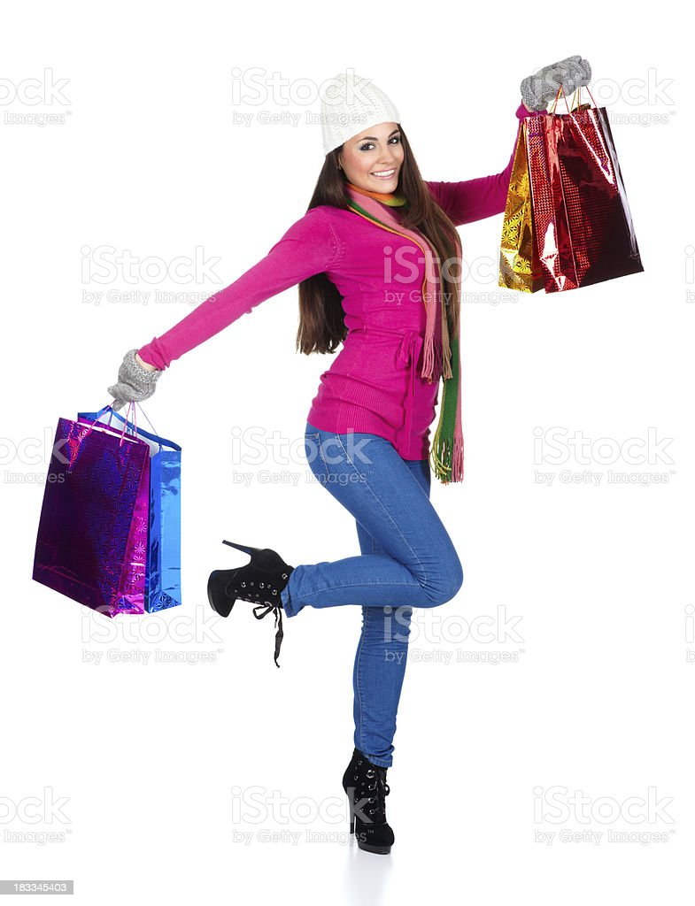 Winter shopping girl with bags royalty-free stock photo