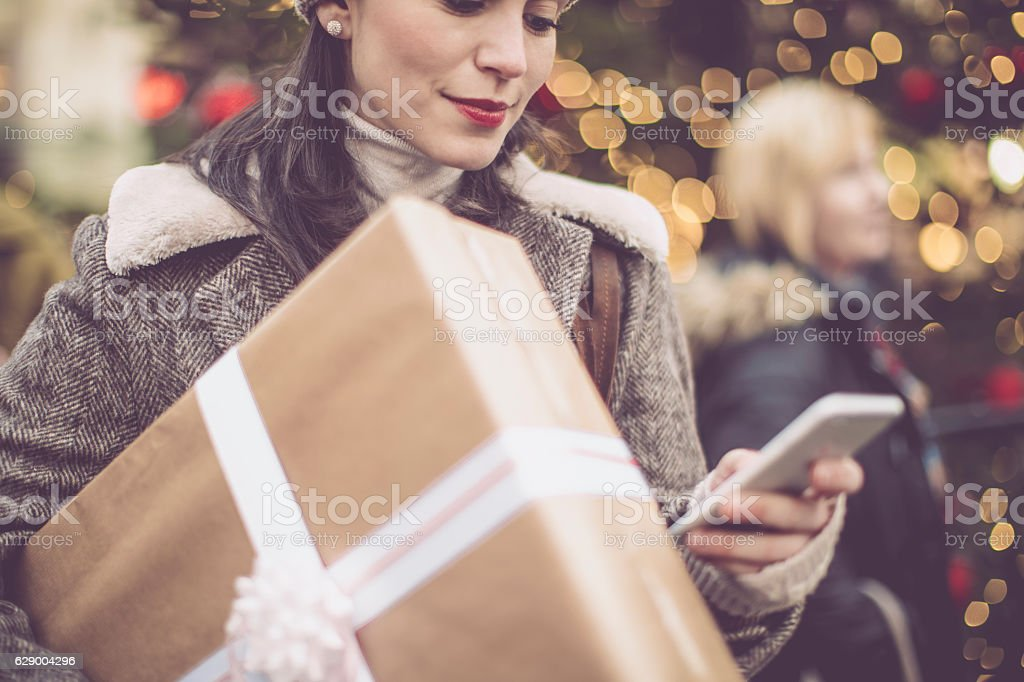 Winter shopping season Young woman shopping in the city at Christmas time 20-29 Years Stock Photo